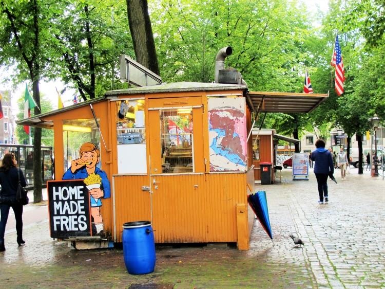 Food stall selling fries in Amsterdam, next to a canal and near the Anne Frank house