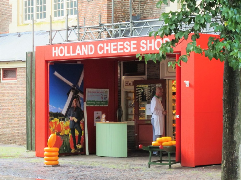 A man in front of the Holland Cheese Shop in Amsterdam