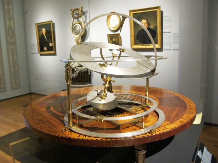 An armillary sphere, an astronomical tool, on a wooden table in the Rijksmuseum