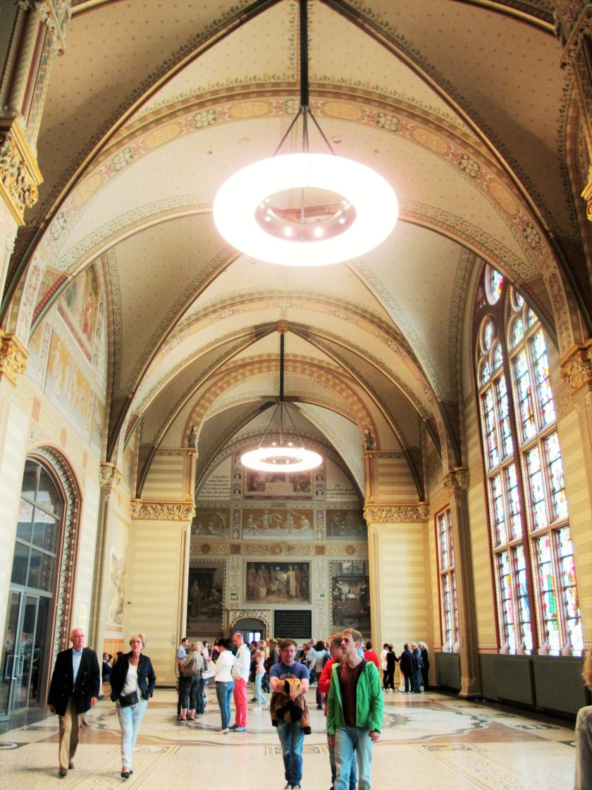 A hall filled with people in an Amsterdam museum