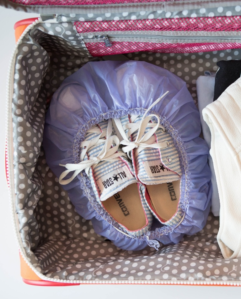 Cover the soles of your shoes with a shower cap for packing purposes