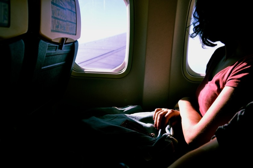 Woman sitting in plane window seat
