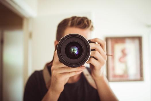 Man taking photo with DSLR