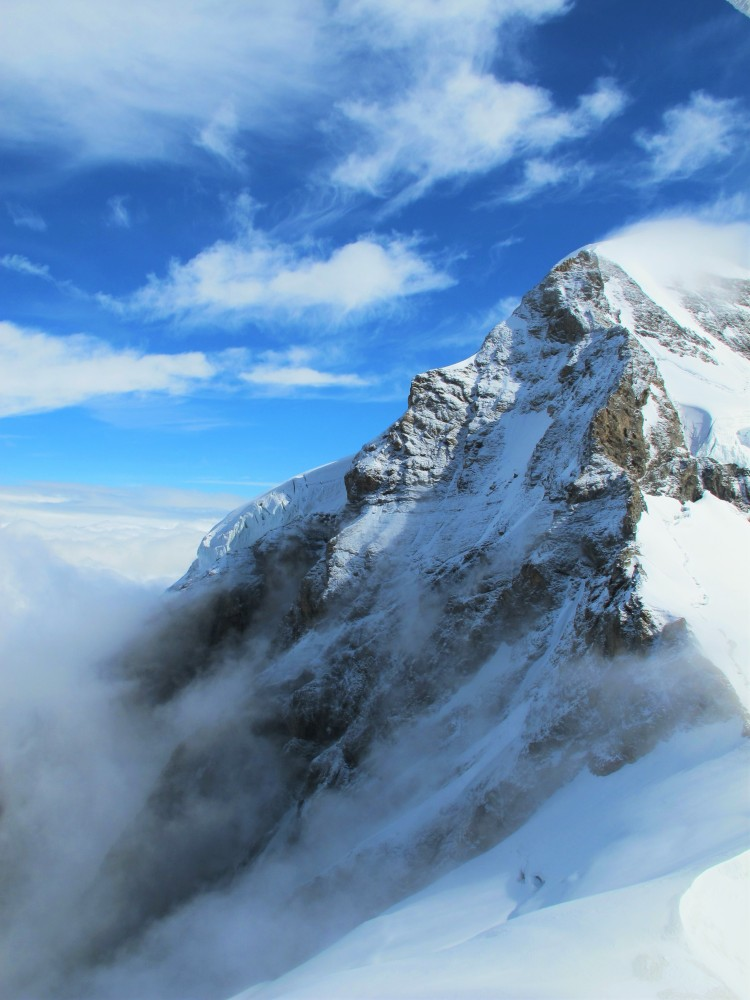 Snowcapped mountain peaks  shrouded with clouds near the Jungfrau in Interlaken, Switzerland