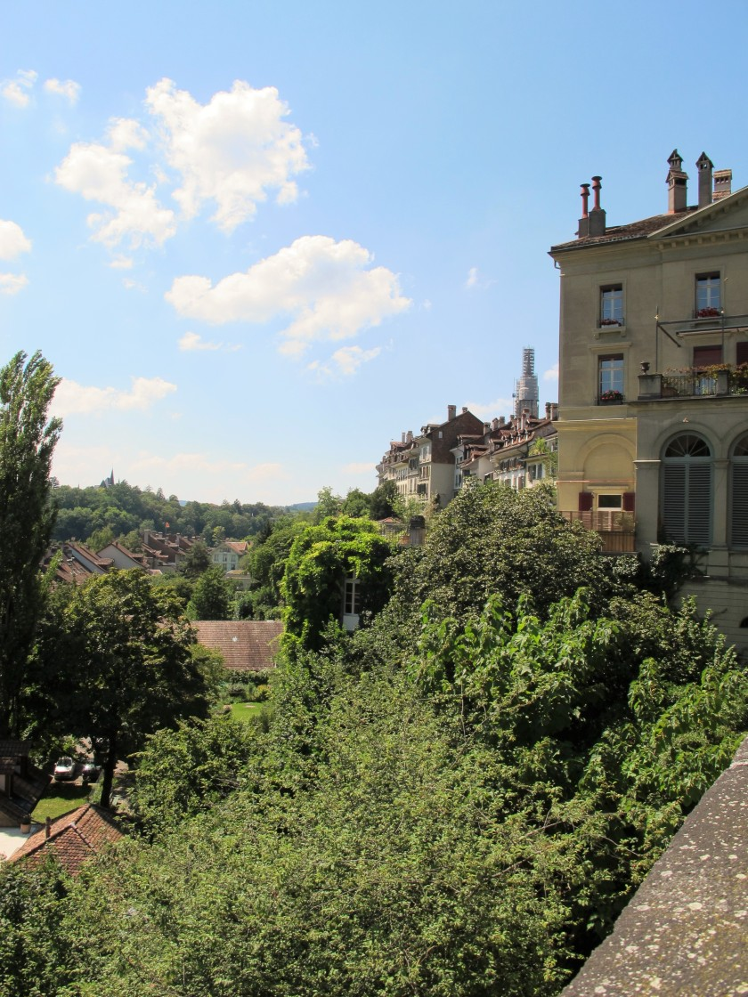 The characteristic architecture of Bern against a lush backdrop of trees and greenery