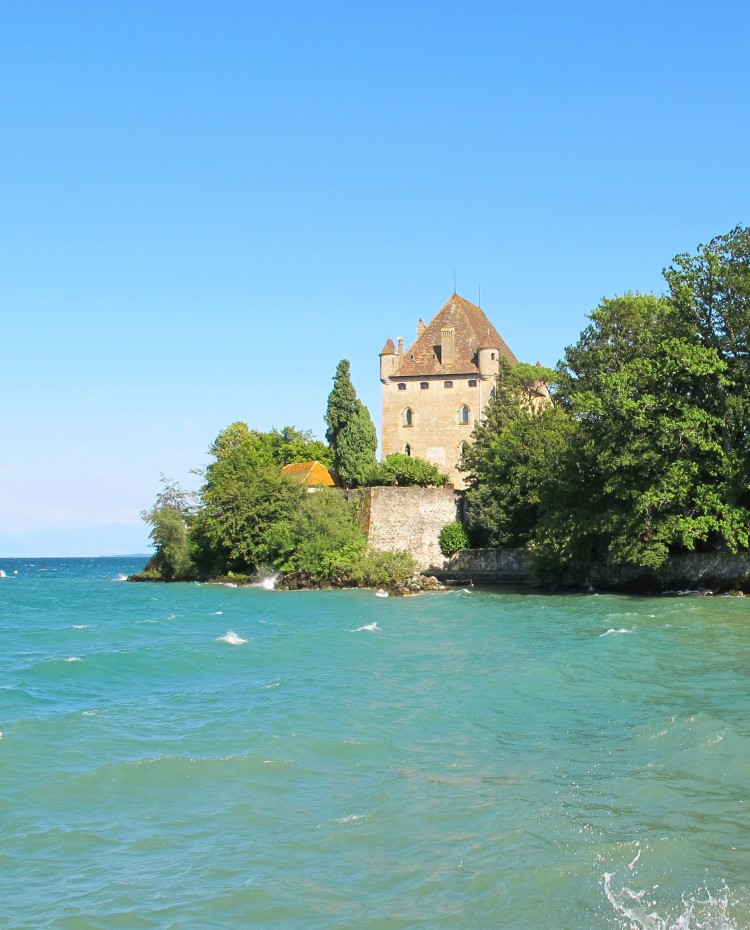 "The Chateau d""Yvoire, a French castle situated on the shores of Lake Geneva, as seen from afar"