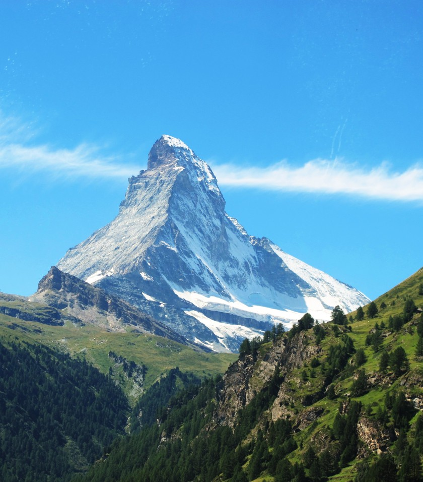 The Matterhorn peak towers above Zermatt, on a blue sunny beautiful day in Switzerland.