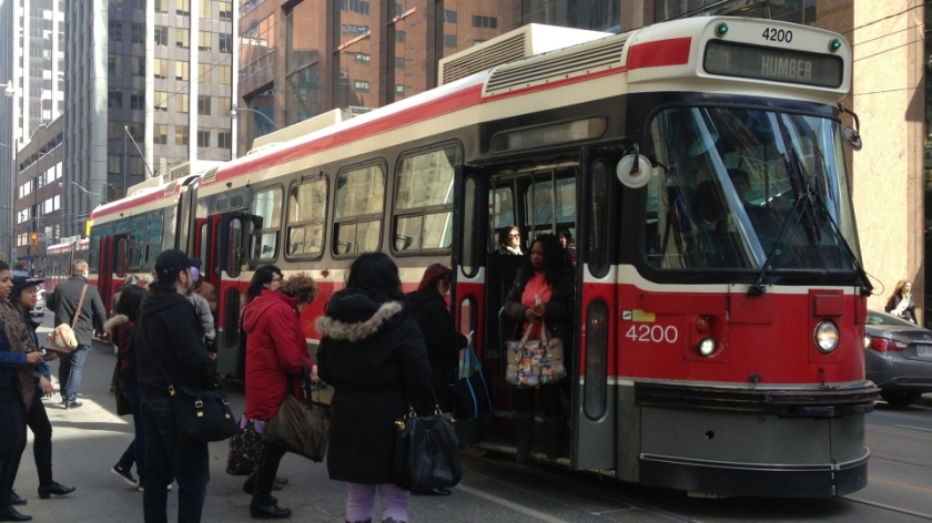 Toronto commuters boarding a streetcar downtown