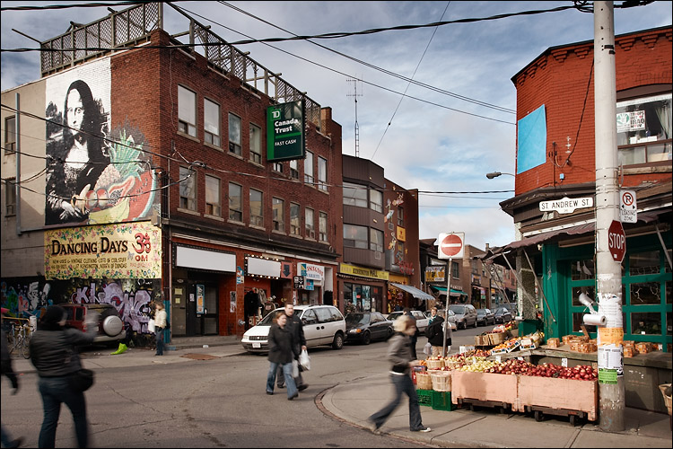 A street corner in Kensington market, with a fruit stall in the foreground