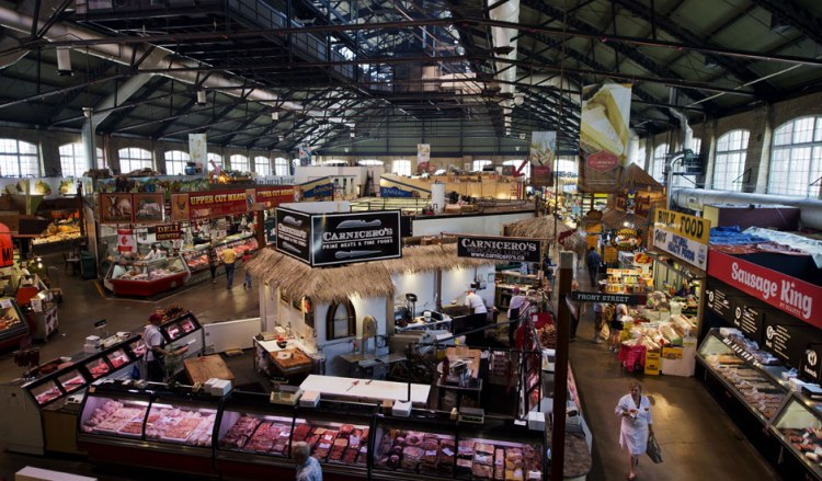 The interior of the St. Lawrence Market in Toronto, filled with any food vendors
